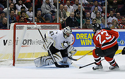 Mar 14, 2007; East Rutherford, NJ, USA;  Pittsburgh Penguins goalie Jocelyn Thibault (41) makes a save on New Jersey Devils center Scott Gomez (23) during the first period at Continental Airlines Arena in East Rutherford, NJ. Mandatory Credit: Ed Mulholland-US PRESSWIRE Copyright © 2007 Ed Mulholland