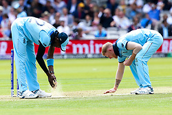 Jofra Archer of England and Ben Stokes of England apply sawdust onto the wicket - Mandatory by-line: Robbie Stephenson/JMP - 14/07/2019 - CRICKET - Lords - London, England - England v New Zealand - ICC Cricket World Cup 2019 - Final