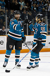 March 19, 2011; San Jose, CA, USA;  San Jose Sharks center Patrick Marleau (12) is congratulated by defenseman Dan Boyle (22) after scoring a goal against the St. Louis Blues during the first period at HP Pavilion. Mandatory Credit: Jason O. Watson / US PRESSWIRE