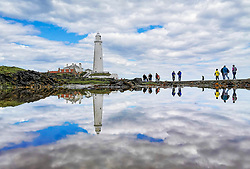 © Licensed to London News Pictures. 15/05/2020. Whitley Bay, UK. People visit St Mary's Lighthouse in Whitley Bay on the North East coast. High temperatures and sunshine are expected to bring more people to the coast over the weekend as some lockdown measures are eased. Photo credit: Colin Scarr/LNP