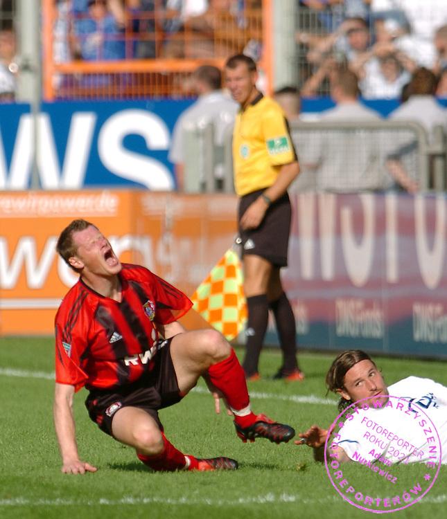 n/z.: Jacek Krzynowek (nr16-Bayer) , VfL Bochum (biale) - Bayer Leverkusen (czerwone-czarne) 2:2 , I Bundesliga , 2 kolejka sezon 2004/2005 , pilka nozna , Niemcy , Bochum , 15-08-2004 , fot.: Adam Nurkiewicz / mediasport.pl..Jacek Krzynowek (nr16-Bayer) injured during Germany league first division soccer match in Bochum. August 15, 2004 , VfL Bochum (white) - Bayer Leverkusen (red-black) 2:2 , 2  round season 2004/2005 , football , Germany , Bochum ( Photo by Adam Nurkiewicz / mediasport.pl )...