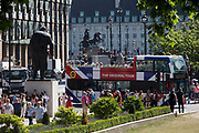 A tour bus with The Original Tour drives past the statues of Winston Churchill and Boadicea in Parliament Square, on 7th July 2017, in central London.