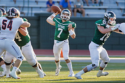 {BLOOMINGTON, IL: Brandon Bauer getting protection from Tyler Jones during a college football game between the IWU Titans  and the Wheaton Thunder on September 15 2018 at Wilder Field in Tucci Stadium in Bloomington, IL. (Photo by Alan Look)