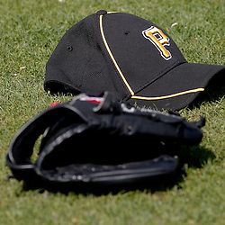 February 21, 2011; Bradenton, FL, USA; A detailed view of a Pittsburgh Pirates hat and players glove on the field during spring training at Pirate City minor league training complex.  Mandatory Credit: Derick E. Hingle