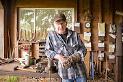 Bob Denman takes a break in the forge at Red Pig Tools.