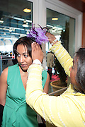 April 7, 2012 New York, NY:  Women get bonnet placed on her head at the 62nd Annual Women of Distinction Spirit Awards Luncheon & Fashion Show sponsored by The Links, Inc- Greater New York Chapter held at Pier Sixty at Chelsea Piers on April 7, 2012 in New York City...Established in 1946, The Links,  incorporated, is one of the nation's oldest and largest volunteer service of women, linked in friendship, are committed to enriching, sustaining and ensuring the culture and economic survival of African-American and persons of African descent . The Links Incorporated is a not-for-profit organization, which consists of nearly 12, 000 professional women of color in 272 located in 42 states, the District of Columbia and the Bahamas. (Photo by Terrence Jennings)