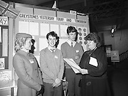 11/01/1985.01/11/1985.11th January 1985.The Aer Lingus Young Scientist Exhibition at the RDS Dublin ..Gemma Hussey, T.D. (right) Minister for Education chatting with Daragh O'Toole (second from left) and Fin Kelleher (third from left) both of St. David's Secondary School, Greystones, Co. Wicklow at their stand showing the 'Development of Greystones' with Aer Lingus Hostess Sally Ann Flanagan.