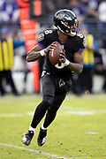 Baltimore Ravens rookie quarterback Lamar Jackson (8) looks to pass as he runs for a fourth quarter gain of 2 yards to the Ravens 48 yard line during the NFL week 11 regular season football game against the Cincinnati Bengals on Sunday, Nov. 18, 2018 in Baltimore. The Ravens won the game 24-21. (©Paul Anthony Spinelli)