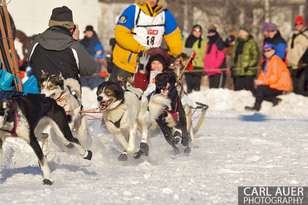 March 7th, 2009:  Anchorage, Alaska - The dogs of Bjornar Andersen from Elverum, Norway make the turn from 4th Avenue onto Cordova during the Start of the 2009 Iditarod Sled Dog Race.