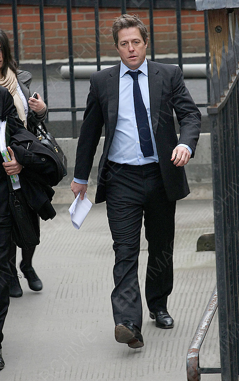 21.NOVEMBER.2011. LONDON<br /> <br /> LEVINSON ENQUIRY - HUGH GRANT, MAX MOSELEY AND MILLY DOWLER ATTEND COURT REGARDING MEDIA ETHNICS<br /> <br /> BYLINE: EDBIMAGEARCHIVE.COM<br /> <br /> *THIS IMAGE IS STRICTLY FOR UK NEWSPAPERS AND MAGAZINES ONLY*<br /> *FOR WORLD WIDE SALES AND WEB USE PLEASE CONTACT EDBIMAGEARCHIVE - 0208 954 5968*
