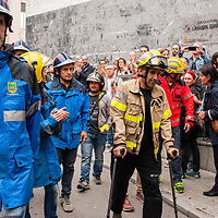 Saturday, 01 October 2017. Terrassa, Catalonia.  Catalan referendum voting. A delegation of Basque firefighters observers. Activists and voters has been inside and at the door of their assigned polling stations as a measure to try to avoid the closure of the voting places by the spanish police. Despite of many others towns and cities of Catalonia were the day has left about eight hundred injured people, in Terrassa the day has passed with any relevant incident. The elderly people who attended to vote has been welcomed with clapping hands.