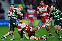 London Irish Full Back (#15) Tom Homer is tackled by Gloucester Number 8 (#8) Sione Kalamafoni and Fly-Half (#10) Freddie Burns during the first half of the match - Photo mandatory by-line: Rogan Thomson/JMP - Tel: Mobile: 07966 386802 15/12/2012 - SPORT - RUGBY - Kingsholm Stadium - Gloucester. Gloucester Rugby v London Irish - Amlin Challenge Cup Round 4.