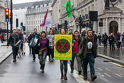 London, UK. 16th April 2019. Climate change activists from Extinction Rebellion walk up Regent Street on the second day of International Rebellion activities to call on the British government to take urgent action to combat climate change.
