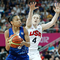 11 August 2012: France Edwige Lawson-Wade drives past USA Lindsay Whalen during 86-50 Team USA victory over Team France, during the Women's Gold Medal Game, at the North Greenwich Arena, in London, Great Britain.
