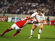 Photo ©Sportzpics 2007 - Rugby World Cup. England v Tonga. Andy Gommersall is caught in the tackle at the Parc des Princes, Paris, France. Friday 28 September 2007.