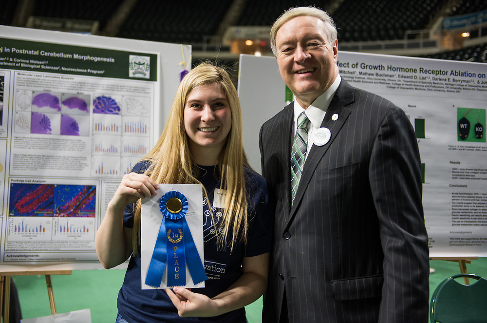 Amelia Hagman poses for a picture with Ohio University President Duane Nellis during the 2018 Student Research Expo.