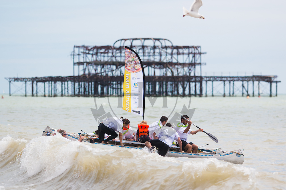 Brighton, UK. Paddle Something Unusual, Part of Paddle Round The Pier 2016, the biggest free charity beach festival in the world takes place every year on Hove Lawns in Brighton and celebrated 20 years last weekend. Photo Credit: Hugo Michiels