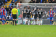 Chelsea players celebrate their 3rd goal during the Barclays Premier League match between Crystal Palace and Chelsea at Selhurst Park, London, England on 3 January 2016. Photo by Shane Healey.