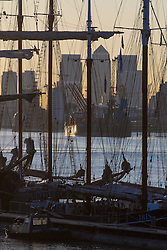 Woolwich, London, September 14th 2016. A tangle of rigging is silhouetted against the background of Docklands as Tall ships gather for the Sail Greenwich Festival 2016 on the River Thames at Woolwich.  &copy;Paul Davey<br /> FOR LICENCING CONTACT: Paul Davey +44 (0) 7966 016 296 paul@pauldaveycreative.co.uk