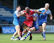 Simon Grix (R) of Halifax RLFC tackles Robert Lui (C) of Salford Red Devils during the Super 8s The Qualifiers match at Mbi Shay Stadium, Halifax<br /> Picture by Stephen Gaunt/Focus Images Ltd +447904 833202<br /> 02/09/2018
