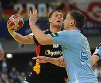 Handball EM Herren 2010 Vorrunde Slowenien - Deutschland 20.01.2010 Michael Kraus (GER links) gegen Miladin Kozlina (SLO)