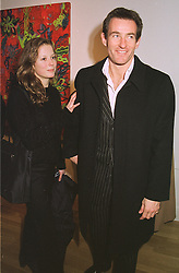 MISS CATHERINE BOOTH and MR TIM JEFFRIES the former husband of Koo Stark, at an exhibition in London on 16th February 1999.MOJ 1