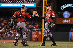 SAN FRANCISCO, CA - APRIL 20: Brad Ziegler #29 of the Arizona Diamondbacks celebrates with Welington Castillo #7 after the game against the San Francisco Giants at AT&T Park on April 20, 2016 in San Francisco, California. The Arizona Diamondbacks defeated the San Francisco Giants 2-1. (Photo by Jason O. Watson/Getty Images) *** Local Caption *** Brad Ziegler; Welington Castillo