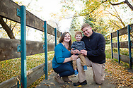 Dramatic, fun family pictures on a bridge in fall, Niwot