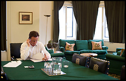 Leader of the Conservative Party David Cameron calling his wife Samantha in his office, January 19, 2010. Photo By Andrew Parsons / i-Images