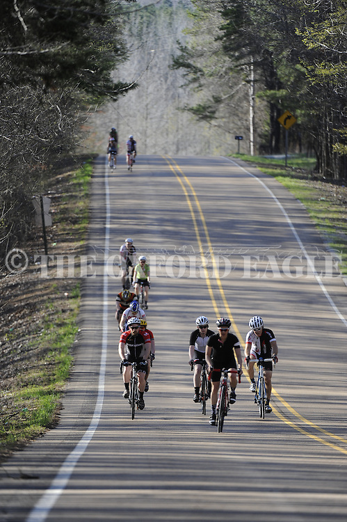 Kim Cross leads members of the Oxford Bike Club on a ride on Delay Road near Tula, Miss. on Monday, March 30, 2015. Cross competes in off-road triathlons and writes a column for BIKE magazine.