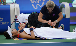 WUHAN, Sept. 28, 2018  Wang Qiang (L) of China receives medical treatment during the singles semifinal match against Anett Kontaveit of Estonia at the 2018 WTA Wuhan Open tennis tournament in Wuhan, central China's Hubei Province, on Sept. 28, 2018. Anett Kontaveit advanced to the final after Wang Qiang withdrew due to injury. (Credit Image: © Cheng Min/Xinhua via ZUMA Wire)