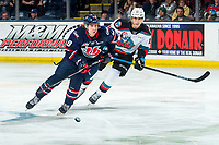 KELOWNA, BC - MARCH 7: Justin Hall #9 of the Lethbridge Hurricanes skates for the puck while pursued by Alex Swetlikoff #17 of the Kelowna Rockets at Prospera Place on March 7, 2020 in Kelowna, Canada. (Photo by Marissa Baecker/Shoot the Breeze)