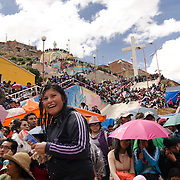 Spectators during Carnival overflow from the stands onto a hillside just west of the city of Oruro.