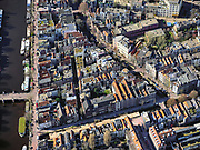 Nederland, Noord-Holland, Amsterdam; 23-03-2020; overzicht binnenstad Amsterdam, Nieuwmarktbuurt. Recht Boomssloot (onder in beeld), schuin de Krom Boomssloot, links Oude Schans.<br /> Het publieke leven in het centrum van de hoofdstad is bijna geheel stil komen te liggen als gevolg van het Corona virus. Niet alleen is alle horeca dicht, ook veel winkels en andere bedrijven zijn gesloten. Het publiek blijft over het algemeen binnen, de straten en pleinen zijn stil.<br /> Innercity Amsterdam.<br /> Public life in the center of the capital has come to a complete standstill as a result of the Corona virus. Not only are all pubs, coffee shops and restaurants,  closed, many shops and other companies are also closed. The public generally stays inside, the streets and squares are very quiet.<br /> <br /> luchtfoto (toeslag op standaard tarieven);<br /> aerial photo (additional fee required)<br /> copyright © 2020 foto/photo Siebe Swart