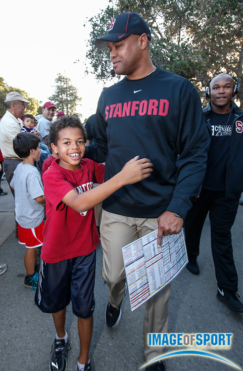 Oct 5, 2013; Stanford, CA, USA; Stanford Cardinal head coach David Shaw (right) and son Carter Shaw during the team walk prior to game against the Washington Huskies at Stanford Stadium. Stanford defeated Washington 31-28.
