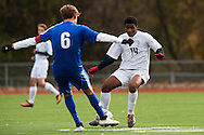 Burlington's Peter Makuni (14) and Mount Anthony's Jack Peterson (6) battle for the ball during the quarterfinal boys soccer game between Mount Anthony and Burlington at Buck Hard Field on Friday afternoon October 23, 2015 in Burlington. (BRIAN JENKINS/ for the FREE PRESS)