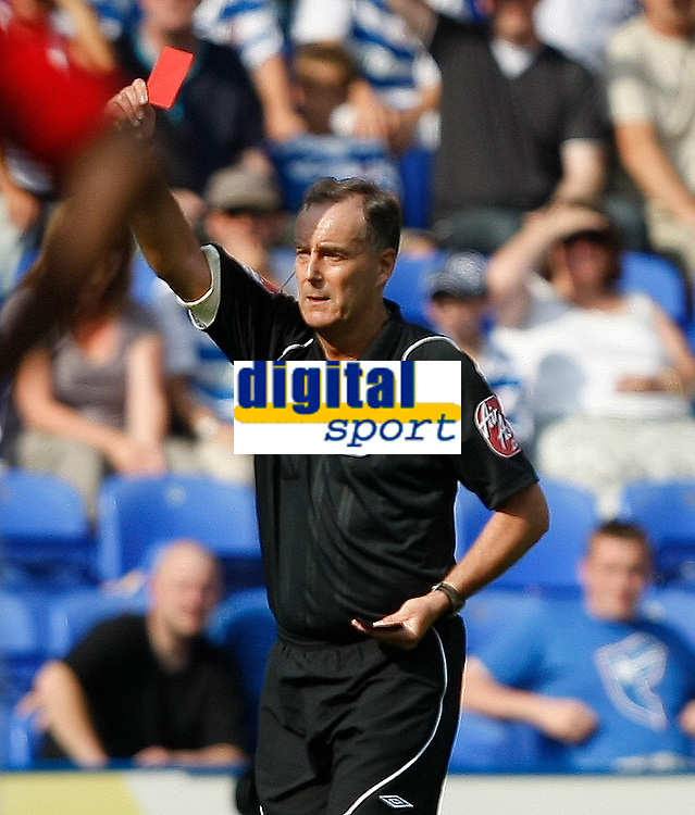 Photo: Steve Bond/Richard Lane Photography. Reading v Nottingham Forest. Coca Cola Championship. 08/08/2009. Ref Phil Crossley shows the red card towards Luke Chambers