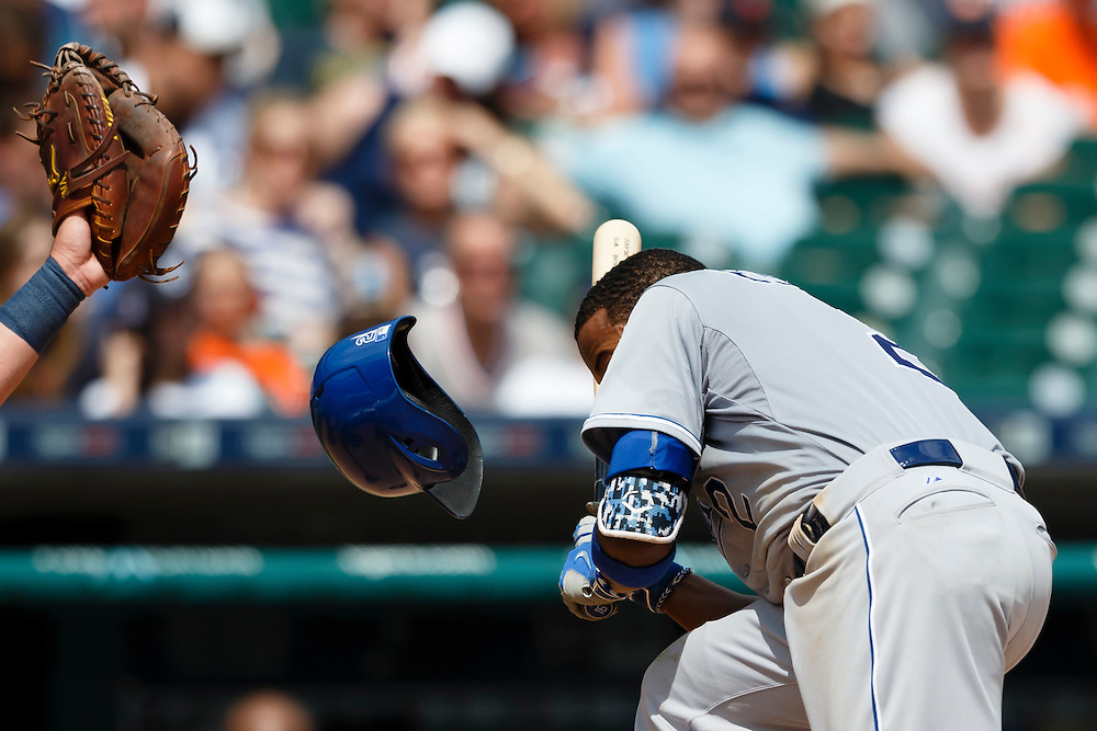 May 9, 2015; Detroit, MI, USA; Kansas City Royals shortstop Alcides Escobar (2) reacts to an inside pit in the eighth inning against the Detroit Tigers at Comerica Park. Mandatory Credit: Rick Osentoski-USA TODAY Sports