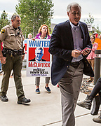 "California Congressman TOM MCCLINTOCK arrives at the Truckee Tahoe Airport for a private, closed-door meeting with the Contractors Association of Truckee Tahoe (CATT) in Truckee, California, on Tuesday, August 22, 2017. Approximately 50-60 protesters were on site. According to several local-area residents in attendance, they've been requesting a town hall meeting with McClintock for approximately two years without luck. Protester Paco Lindsay said that the protest was ""in no way a reflection at all on CATT."" McClintock represents the 4th district of California."