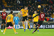 Wolverhampton Wanderers defender Ryan Bennett (5) heads clear during the Premier League match between Wolverhampton Wanderers and Bournemouth at Molineux, Wolverhampton, England on 15 December 2018.