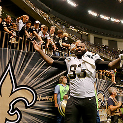 Sep 21, 2014; New Orleans, LA, USA; New Orleans Saints outside linebacker Junior Galette (93) celebrates after a win against the Minnesota Vikings in a game at Mercedes-Benz Superdome. The Saints defeated the Vikings 20-9. Mandatory Credit: Derick E. Hingle-USA TODAY Sports