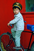 Young boy playing on a bicycle, Beijing, China