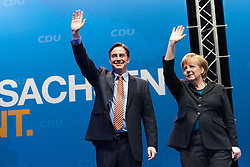 The half-Scottish governor of Lower Saxony, David McAllister and German Chancellor Angela Merkel during an election campaign event at Hildesheim, Germany..©Michael Schofield.
