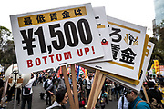 A protester holds a placards demanding a higher wage in Tokyo April 15, 2017, Japan. A Group of young people named Aequitas who means Equity in Latin, organised a demonstration to demanded a minimum hourly wage of 1,500 JPY (approx. USD 13.7), currently the minimum wage ranges from 700 to 900 JPY (approx. USD from 6,4 to 8,3). 15/04/2017-Tokyo, JAPAN