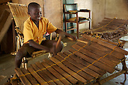 A school boy playing music at Tizza Primary School in Ghana.