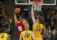 January 19 2013: Wisconsin Badgers forward Ryan Evans (5) tries to shoot around Iowa Hawkeyes center Adam Woodbury (34) during the first half of the NCAA basketball game between the Wisconsin Badgers and the Iowa Hawkeyes at Carver-Hawkeye Arena in Iowa City, Iowa on Sautrday January 19 2013. Iowa defeated Wisconsin 70-66.