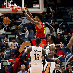 Mar 26, 2019; New Orleans, LA, USA; Atlanta Hawks forward John Collins (20) dunks over New Orleans Pelicans center Julius Randle (30) and forward Cheick Diallo (13) during the second half at the Smoothie King Center. Mandatory Credit: Derick E. Hingle-USA TODAY Sports