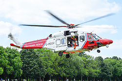 © Licensed to London News Pictures. 03/07/2019. LONDON, UK.  A Coastguard Rescue helicopter takes off from Regent's Park after collecting equipment from a Children's Acute Transport Service (CATS) ambulance on behalf of nearby Great Ormond Street Hospital.  The helicopter will make the journey to collect a sick child who will be brought back for treatment at Great Ormond Street as travel by road would take too long.  Photo credit: Stephen Chung/LNP