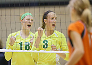 Kennedy's Brinley Milbrath and Jordan Calef (from left) celebrate after a score during their game against Tripoli at the Westside Volleyball Invitational at Jefferson High School in Cedar Rapids on Saturday October 6, 2012. Tripoli defeated Kennedy 25-19 and 25-21.