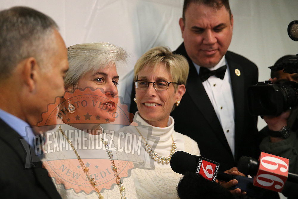 Osceola County Commisioner Cheryl Grieb, left, and Patti Daugherty, right, speak to the media after becoming the first same sex couple to marry each other after midnight on January 6, 2015 at the Osceola County courthouse in Kissimmee, Florida.  (AP Photo/Alex Menendez)